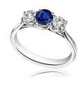 Modern Round Diamond & Blue Sapphire Trilogy Ring