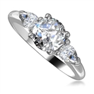 Traditional Round & Pear Diamond Trilogy Ring